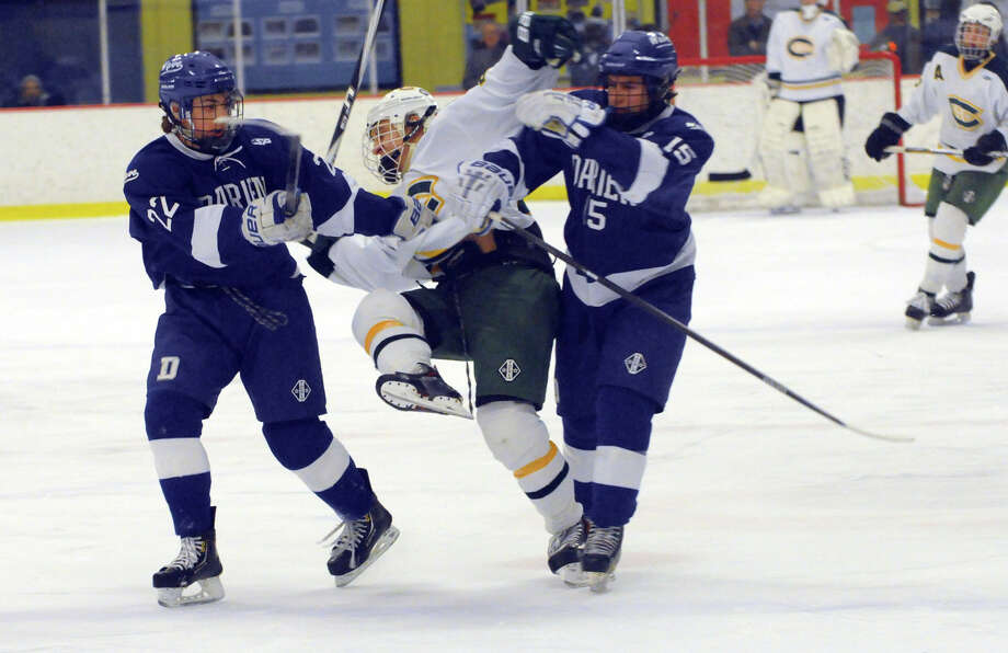 Darien and Trinity Catholic High Schools face off in a boys hockey game at Terry Conners Rink in Stamford, Conn., Jan. 25, 2014. Photo: Keelin Daly / Stamford Advocate Freelance