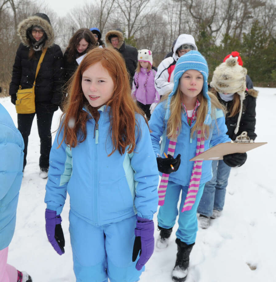 At left, Julia Guillet, 9, of Riverisde, takes part in a Wildlife Tracking Class at Audubon Greenwich, Saturday afternoon, Jan. 25, 2014. Photo: Bob Luckey / Greenwich Time