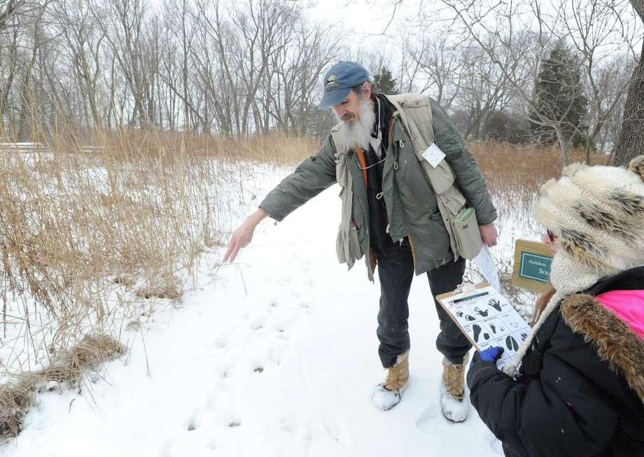 Audubon Greenwich Naturalist Ted Gilman teaches a Wildlife Tracking Class at Audubon Greenwich, Saturday afternoon, Jan. 25, 2014. Photo: Bob Luckey / Greenwich Time