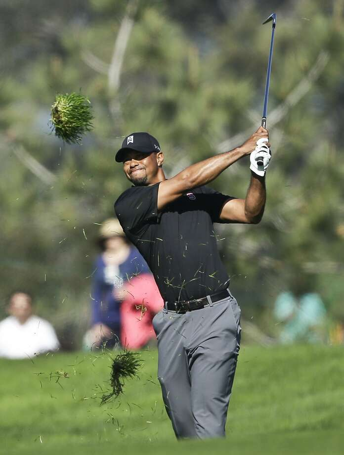 Tiger Woods watches an approach during his round of 7-over 79. Photo: Lenny Ignelzi, Associated Press