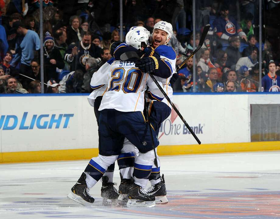 Chris Stewart (right) and Alexander Steen help Kevin Shattenkirk celebrate his winning shootout goal. Photo: Christopher Pasatieri, Getty Images