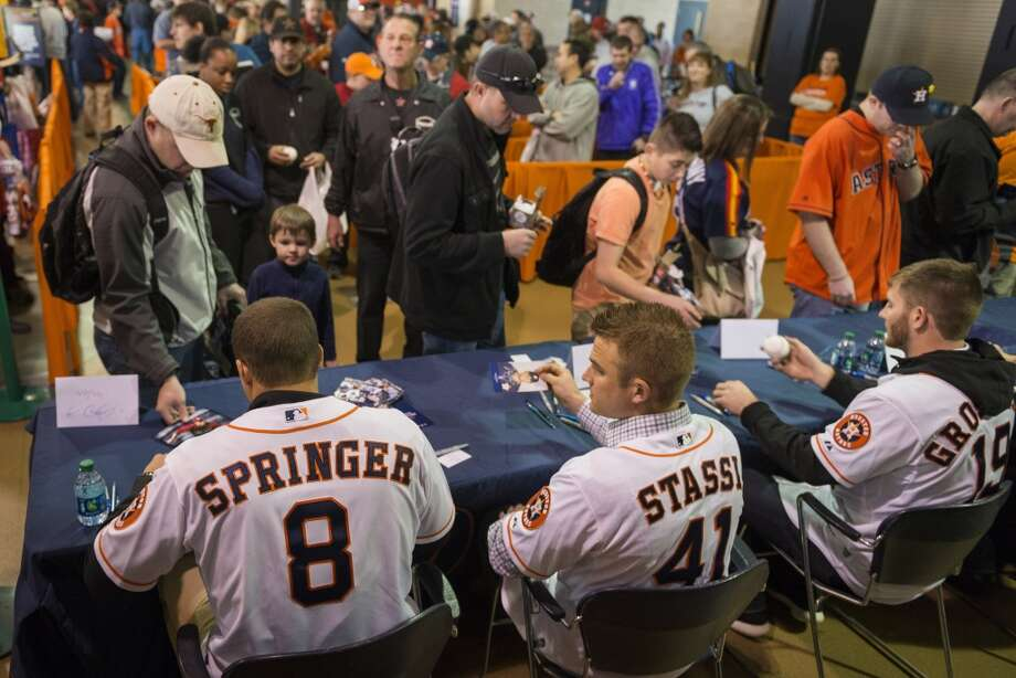 Astros players George Springer (8), Max Stassi (41) and Robbie Grossman (19) sign autographs during the Houston Astros Fanfest. Photo: Smiley N. Pool, Houston Chronicle