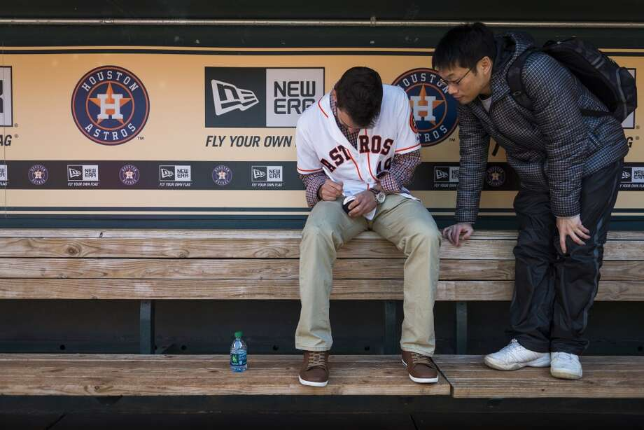 Astros pitcher Jarred Cosart autographs a ball for a fan in the Astros dugout during the Houston Astros Fanfest. Photo: Smiley N. Pool, Houston Chronicle