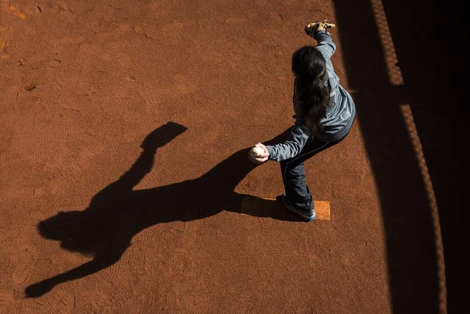 A young fan throws from the mound in the Houston Astros bullpen during the Houston Astros Fanfest. Photo: Smiley N. Pool, Houston Chronicle