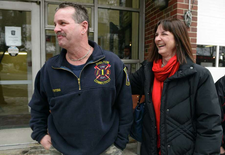 Linda Robak talks to firefighter Billy Tortora following a news conference Saturday, Jan. 25, 2014, at Echo Hose Hook & Ladder Co. in Shelton.  Tortora helped Robak and her daughter escape their apartment on Howe Avenue during a fire that destroyed the building on January 6, 2014. Photo: Autumn Driscoll / Connecticut Post