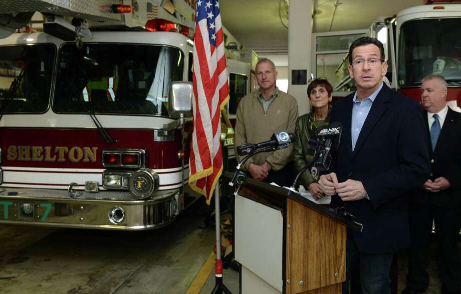 Gov. Dannel P. Malloy speaks at a press conference Saturday, Jan. 25, 2014, at Echo Hose Hook & Ladder Co. in Shelton to announce the approval of his request for a Small Business Administration (SBA) disaster declaration to mitigate the impact of the fire in Shelton that destroyed businesses and apartments on January 6, 2014. Photo: Autumn Driscoll / Connecticut Post