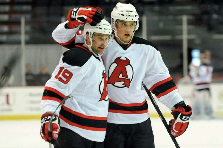 Devils' Mike Sislo, left, and Adam Larsson celebrate a first-period goal during their hockey game against the Phantoms on Saturday, Jan. 25, 2014, at Times Union Center in Albany, N.Y. (Cindy Schultz / Times Union) Photo: Cindy Schultz / 00025430A