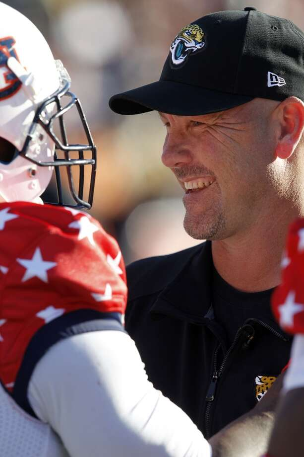 South coach Gus Bradley, of the Jacksonville Jaguars, talks with Dee Ford, of Auburn, on the sidelines. Photo: Butch Dill, Associated Press