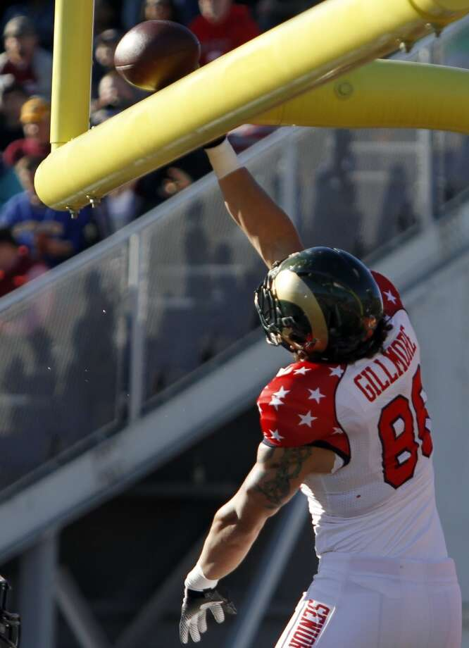 South receiver Crockett Gillmore, of Colorado St., spikes the ball over the crossbar after scoring a touchdown. Photo: Butch Dill, Associated Press