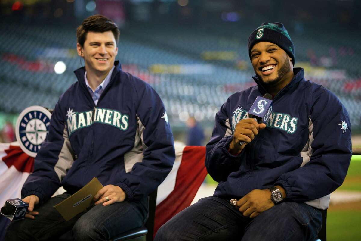 New Mariners second baseman Robinson Cano, right, laughs with fans during a dugout discussion at the 16th annual Mariners FanFest Saturday, Jan. 25, 2014, at Safeco Field in Seattle. Fans could tour the Mariners' clubhouse, ride two different zip lines over Safeco Field and hit a simulated Felix Hernandez fastball in a batting cage. The event runs from 11 a.m. to 4 p.m. on Sunday. Tickets are $10 for adults, with children 14 and under admitted for free.