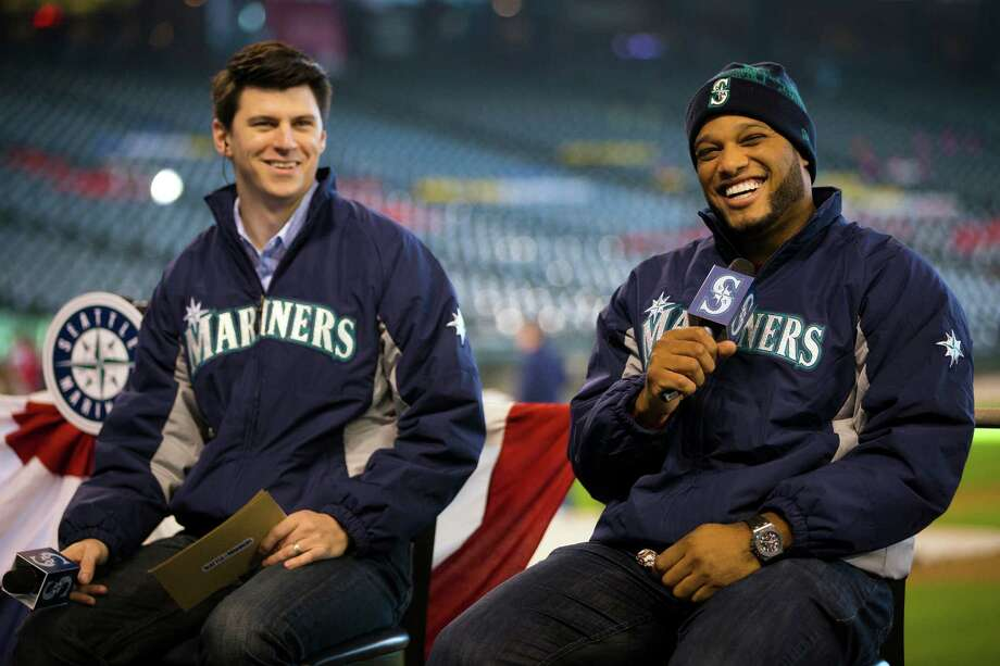 New Mariners second baseman Robinson Cano, right, laughs with fans during a dugout discussion at the 16th annual Mariners FanFest Saturday, Jan. 25, 2014, at Safeco Field in Seattle. Fans could tour the Mariners' clubhouse, ride two different zip lines over Safeco Field and hit a simulated Felix Hernandez fastball in a batting cage. The event runs from 11 a.m. to 4 p.m. on Sunday. Tickets are $10 for adults, with children 14 and under admitted for free. Photo: JORDAN STEAD, SEATTLEPI.COM / SEATTLEPI.COM