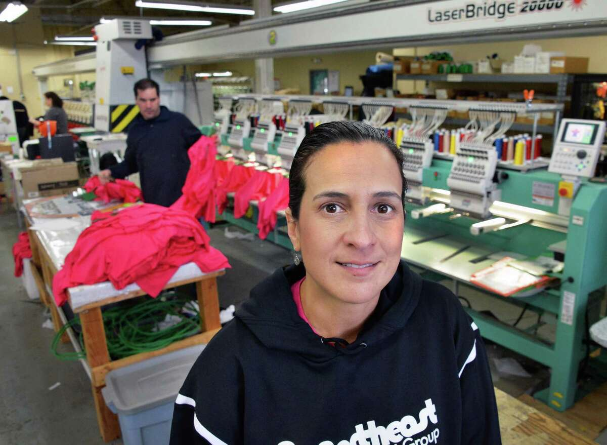 Deana Endieveri, owner and president of Northeast Stitches and Ink in their embroidery department Thursday Jan. 23, 2014, in South Glens Falls, NY.(John Carl D'Annibale / Times Union)