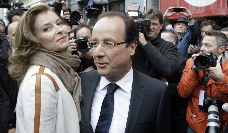An aide confirms that French President Francois Hollande has ended his relationship with Valerie Trierweiler (left) amid reports he is having an affair with actress Julie Gayet. Photo: Lionel Cironneau / Associated Press / AP