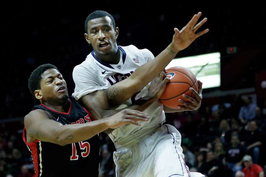 Rutgers guard Craig Brown (15) tries to make a steal on Connecticut forward DeAndre Daniels during the first half of an NCAA college basketball game Saturday, Jan. 25, 2014, in Piscataway, N.J. (AP Photo/Mel Evans) Photo: Mel Evans, Associated Press / Associated Press
