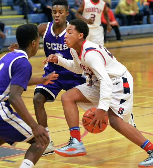 Schenectady High's eighth-grade point guard #23 Tobias Holmes, center, is double teamed during Satur