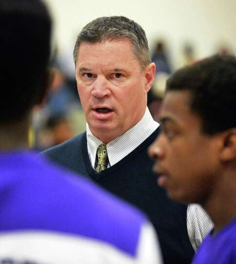 CCHS head coach Chuck Mack with players against during Saturday's game against Schenectady High Jan.