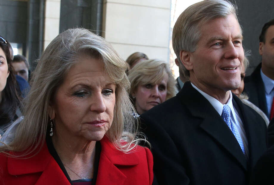 Former Virginia Gov. Bob McDonnell and his wife, Maureen, leave a court in Richmond, Va., Friday after pleading not guilty to a 14-count indictment. Photo: Mark Wilson / Getty Images / 2014 Getty Images