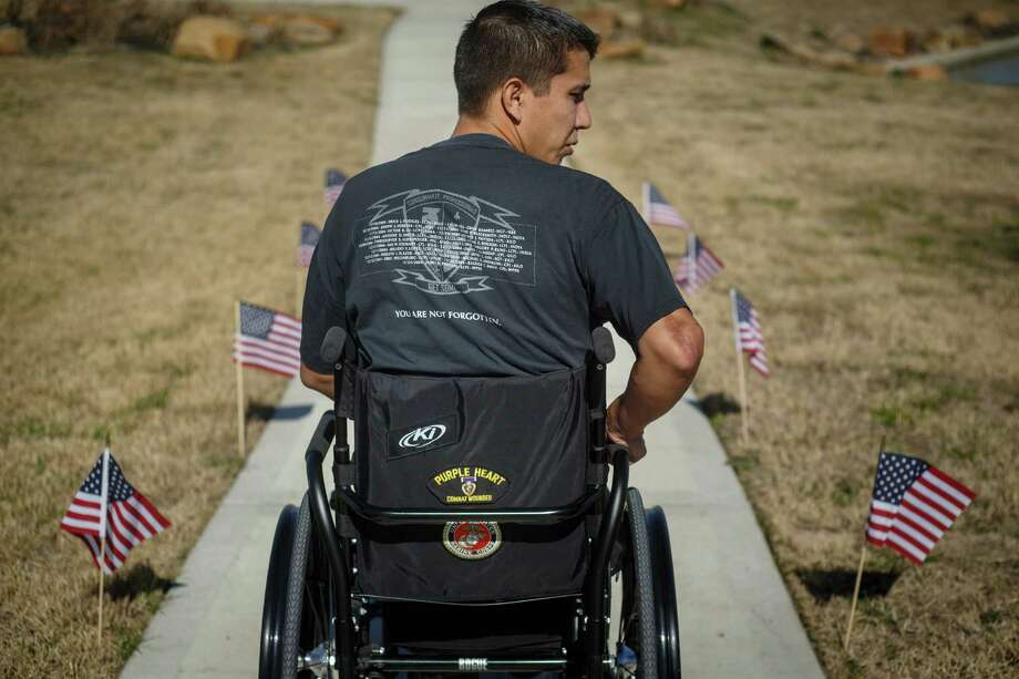 Marine Sgt. Marty Gonzalez was awarded three Purple Hearts and earned two Bronze Stars in Iraq. Photo: Michael Paulsen, Staff / © 2014 Houston Chronicle