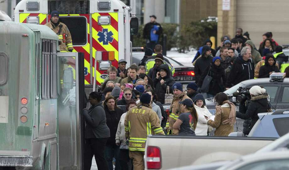 People board shuttle busses as they're evacuated by police and rescue personnel after the shooting at the Mall in Columbia, in the Maryland town of the same name that's a suburb of Baltimore and Washington. Photo: Evan Vucci / Associated Press / AP
