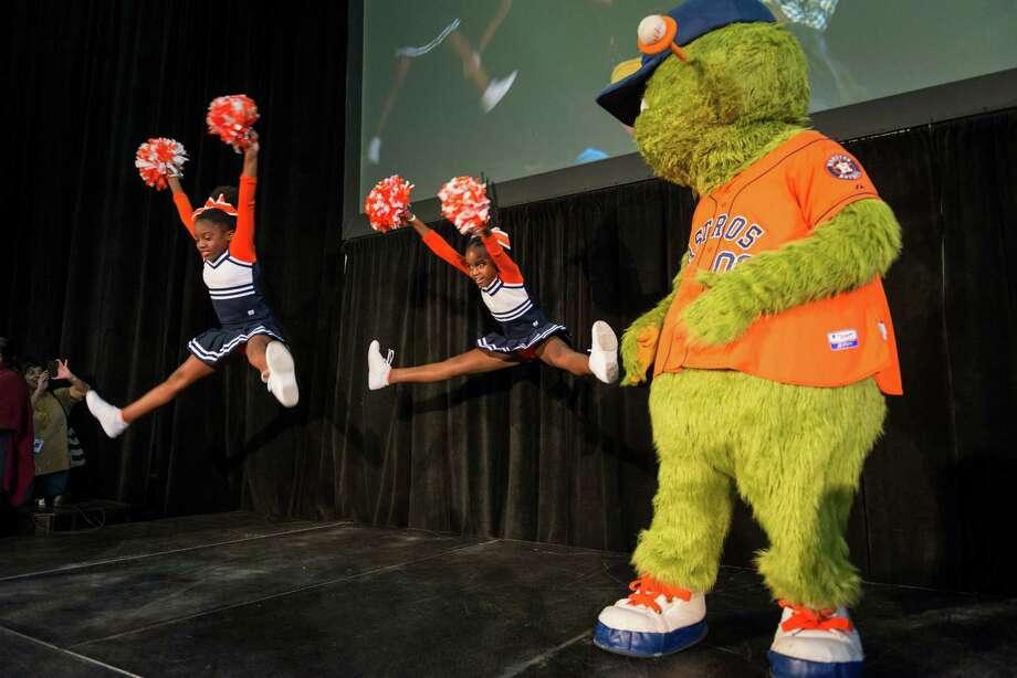 Cheerleaders perform with Houston Astros mascot Orbit during the Official Kickoff of National School Choice Week. ( Smiley N. Pool / Houston Chronicle ) Photo: Smiley N. Pool, Houston Chronicle / © 2014  Smiley N. Pool