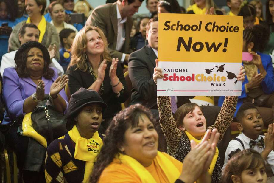 The crowd cheers a during a speech by US Rep. Sheila Jackson Lee at the Official Kickoff of National School Choice Week.  ( Smiley N. Pool / Houston Chronicle ) Photo: Smiley N. Pool, Houston Chronicle / © 2014  Smiley N. Pool