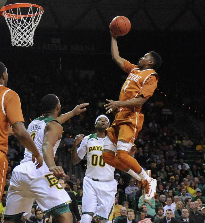 Isaiah Taylor, right, had a license to drive early and often, leading Texas to victory at Baylor on Saturday with an assortment of high-arcing layups. Photo: Rod Aydelotte, MBO / Waco Tribune Herald