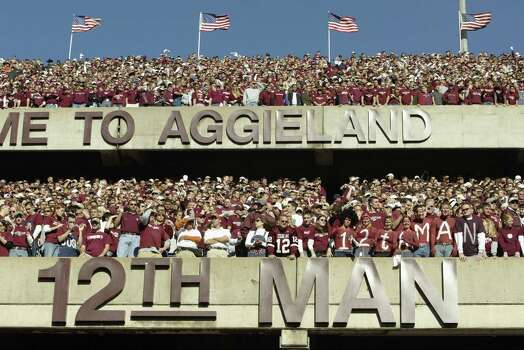 Texas A&M University Aggies fans, sometimes referred to as the 12th Man, stand during the game against the University of Texas at Austin Longhorns, at Kyle Field on November 28, 2003 in College Station, Texas. The Texas Longhorns won 46-15. Photo: Brian Bahr, Getty Images / 2003 Getty Images