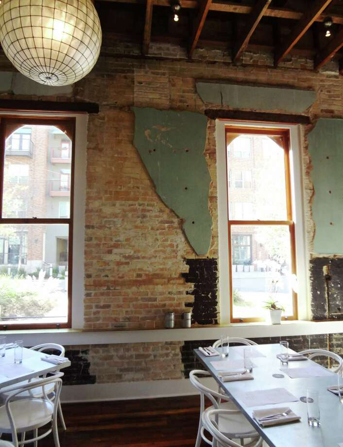 The back dining room at Cured shows the 1904 administrative building's century of use. Photo: Photo By Steve Bennett