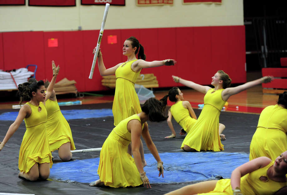 Elisa Deeley, competes with the rest of the Masuk Cologuard Team, during the Winterguard competition at Masuk High School in Monroe, Conn. on Saturday January 25, 2014. The Masuk Cologuard Team as well as the others who've assembled, are comprised of dedicated, passionate students who practice several hours each week. They perfect their skills of tossing and spinning flags, rifles, and sabres and aquire a combination of athletic skills, creative interpretation of music, and theatrical performance. Photo: Christian Abraham / Connecticut Post