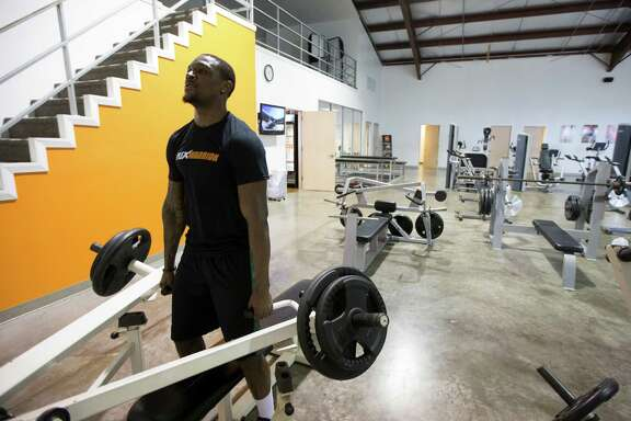 Demetri Goodson works out at Plex Fitness on Thursday, Jan. 23, 2014, in Stafford. He played at Klein Collins and Baylor, and is prepping for the NFL draft.