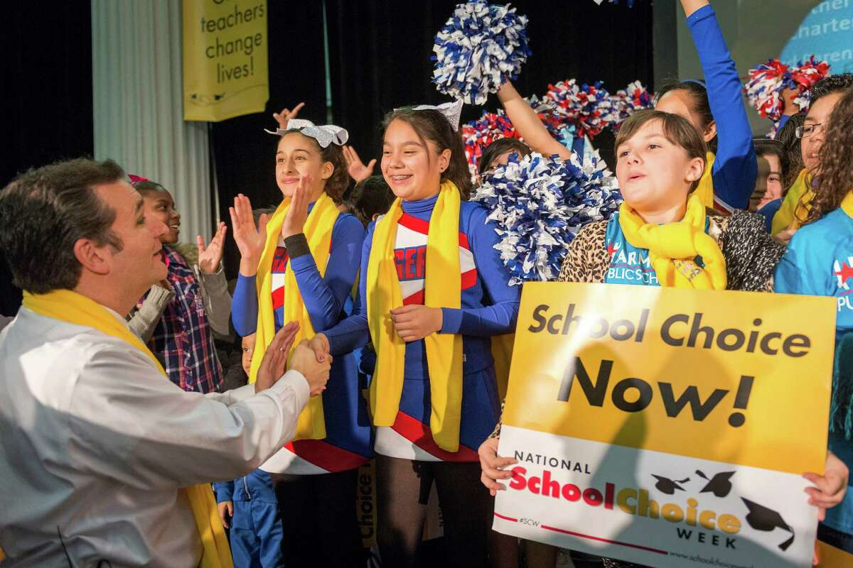 Sen. Ted Cruz and students show their school choice spirit at the kickoff of National School Choice Week at Minute Maid Park. ( Smiley N. Pool / Houston Chronicle )