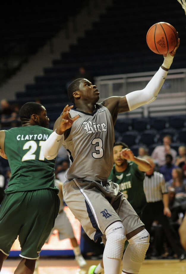 Rice freshman forward Sean Obi, right, controls a rebound in front of Charlotte's Willie Clayton during their game at Tudor Fieldhouse on Saturday. Photo: Jerry Baker, For The Chronicle