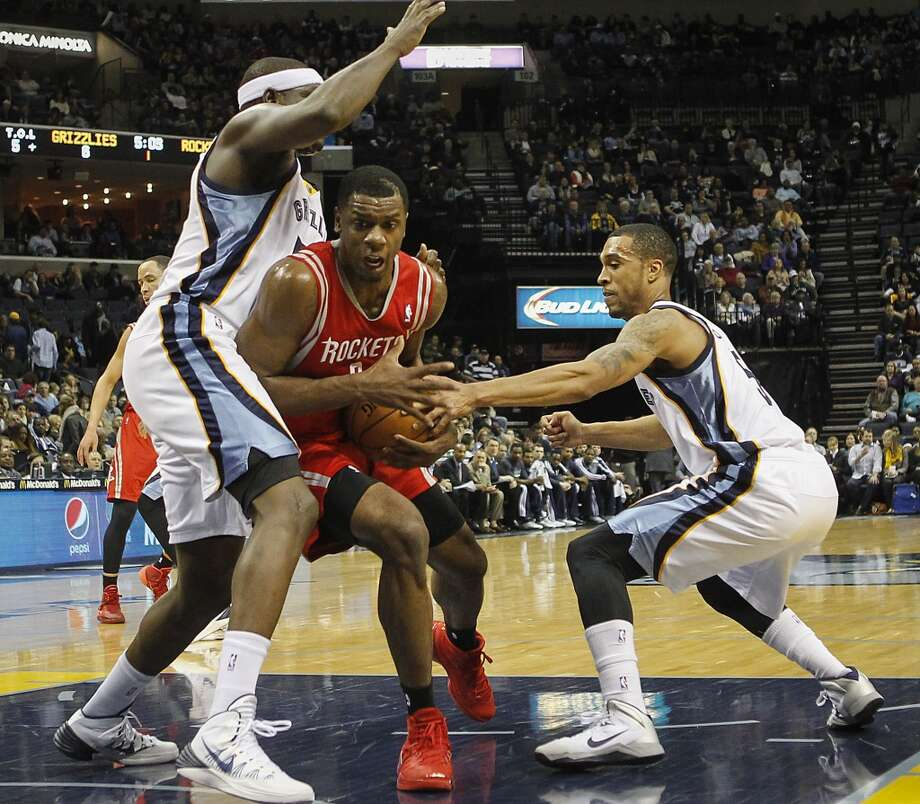 Jan. 25: Grizzlies 99, Rockets 81 Rockets forward Terrence Jones (6) drives between Grizzlies forwards Zach Randolph, left, and Courtney Lee (5). Photo: Lance Murphey, Associated Press
