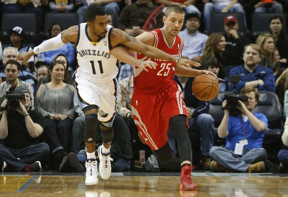 Grizzlies guard Mike Conley (11) tries to steal the ball from Rockets forward Chandler Parsons. Photo: Lance Murphey, Associated Press
