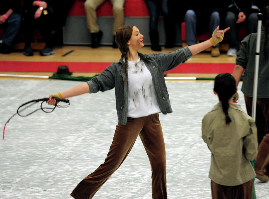 Amanda Glaser, performs with the Newtown High School Junior Varisty Colorguard Team, during the Winterguard Competition at Masuk High School in Monroe, Conn. on Saturday January 25, 2014. The Masuk Cologuard Team as well as the other teams who've assembled, are comprised of dedicated, passionate students who practice several hours each week. They perfect their skills of tossing and spinning flags, rifles, and sabres and aquire a combination of athletic skills, creative interpretation of music, and theatrical performance. Photo: Christian Abraham / Connecticut Post