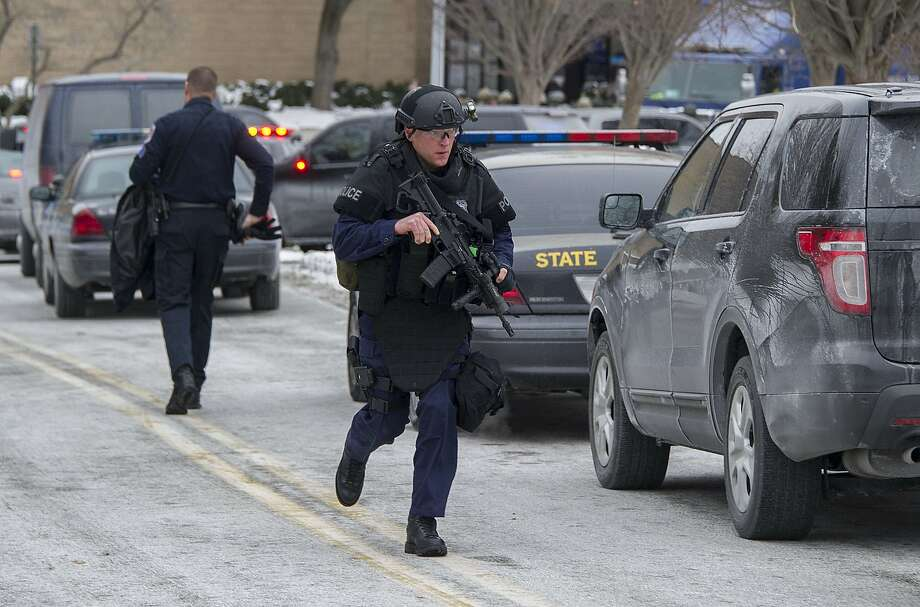 Maryland State Police patrol the Mall in Columbia after a fatal shooting at a skate store inside the popular shopping center. Photo: Jim Watson, AFP/Getty Images