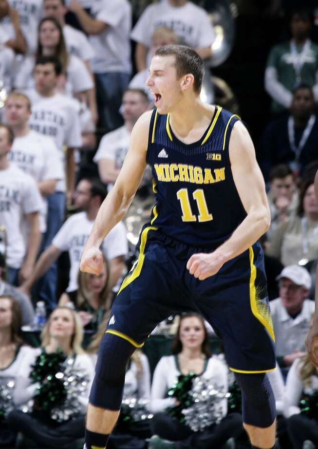 Nik Stauskas cheers his three-pointer that put Michigan ahead for good late in the game. Photo: Al Goldis, Associated Press