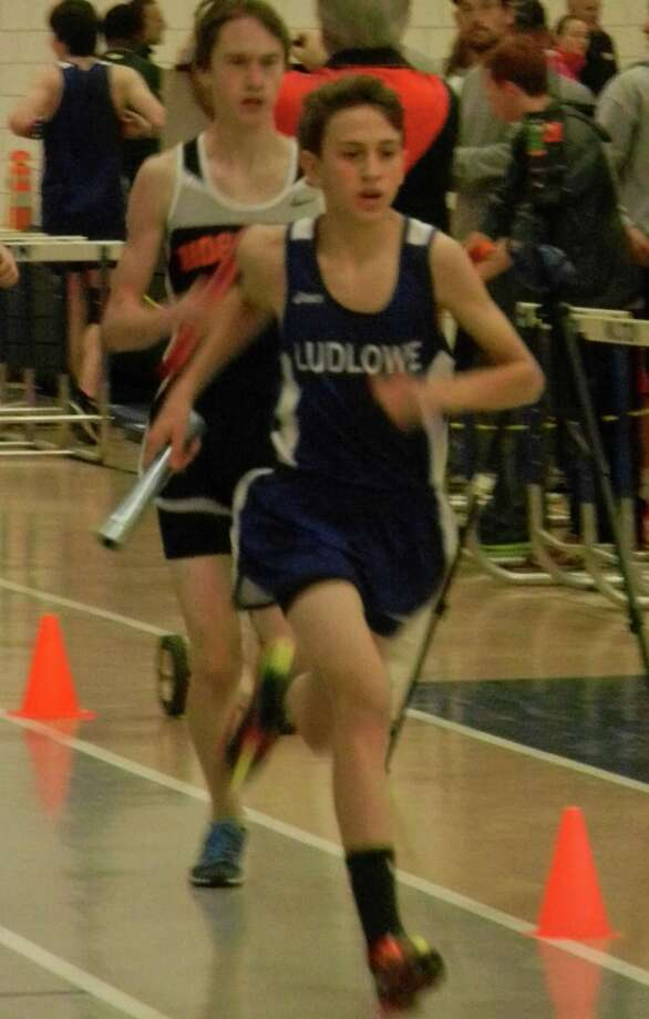 Fairfield Ludlowe freshman Ben Ertel running leadoff in the winning 4 by 750-meter relay on Saturday, Jan. 25 at the FCIAC Central Championships in Wilton. The Falcons' boys team was fourth among five teams. Photo: Reid L. Walmark / Fairfield Citizen