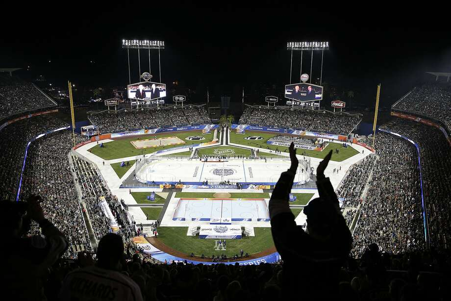 Fans cheer before the hockey game at Dodger Stadium. The rink was set up with the goals near first and third base. Photo: Jae C. Hong, Associated Press