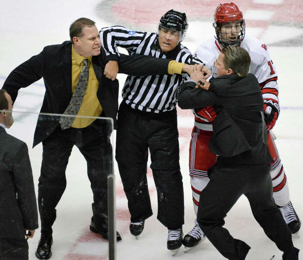 Union head coach Rick Bennett, left, and RPI head coach Seth Appert, at right, are pulled apart by a referee and RPI's #17 Milos Bubela during a bench clearing brawl after RPI beat Union for the Mayor's Cup at the Times Union Center Saturday Jan. 25, 2014, in Albany, NY. (John Carl D'Annibale / Times Union)