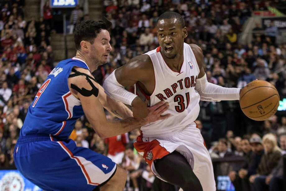 Toronto Raptors' Terrence Ross, (31) drives past Los Angeles Clippers' J.J. Redick during the second half of an NBA basketball game, Saturday, Jan. 25, 2014 in Toronto. (AP Photo/The Canadian Press, Chris Young) ORG XMIT: CHY109 Photo: Chris Young / CP