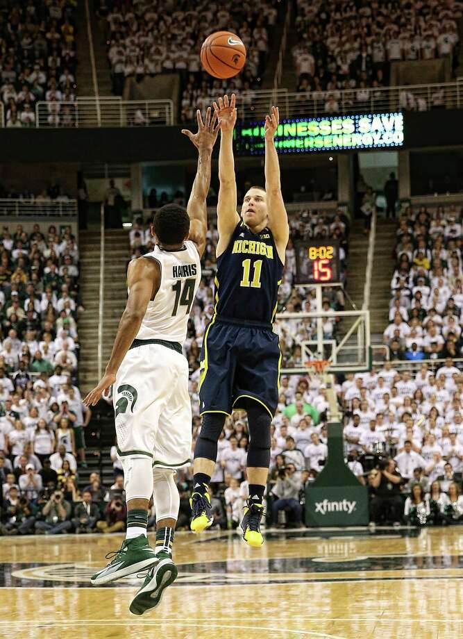 EAST LANSING, MI - JANUARY 25: Nik Stauskas #11 of the Michigan Wolverines shoots over Gary Harris #14 of the Michigan State Spartans defends during the first half of the game at Breslin Center on January 25, 2014 in East Lansing, Michigan.  (Photo by Leon Halip/Getty Images) ORG XMIT: 185392841 Photo: Leon Halip / 2014 Getty Images
