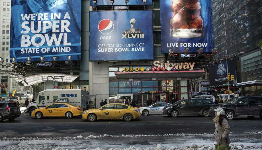 Even with more than a foot of snow last week, the New York/New Jersey area is trying to embrace the first Super Bowl to be played outdoors in a cold-weather city when the Broncos and Seahawks square off next Sunday. Photo: Andrew Burton / Getty Images / 2014 Getty Images