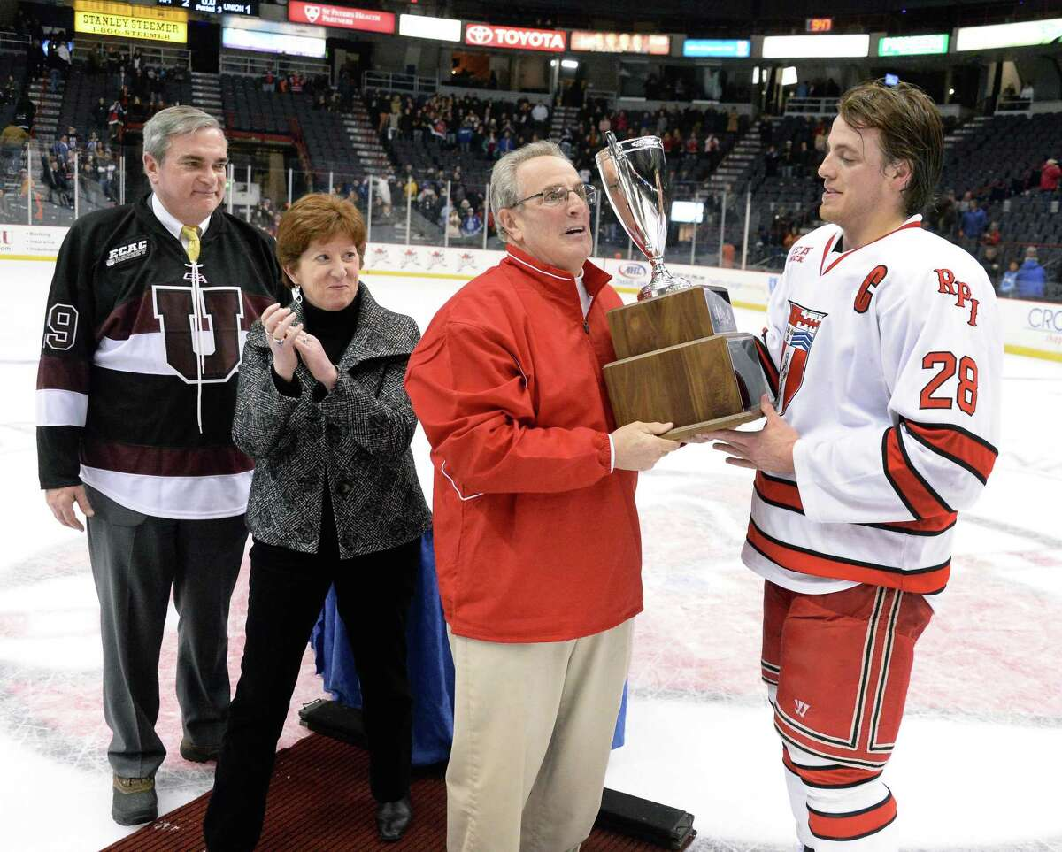 Local mayors, from left, Schenectady's Gary McCarthy, Albany's Kathy Sheehan and Troy's Lou Rosamillia present the Mayor's Cup toRPI's #28 Matt Tinordi RP defeats Union College at the Times Union Center Saturday Jan. 25, 2014, in Albany, NY. (John Carl D'Annibale / Times Union)