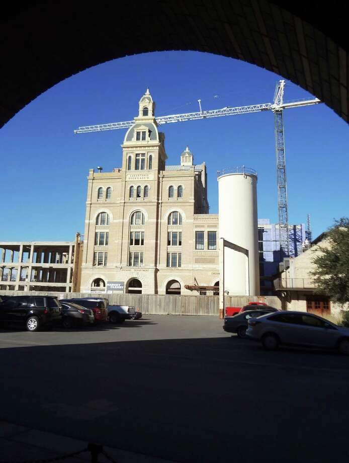 The 1881 Pearl brew house is now Hotel Emma, featuring reused materials including a circular staircase in the Great Hall and old blueprints, architectural drawings and maps framed for art. Photo: Steve Bennett / San Antonio Express-News