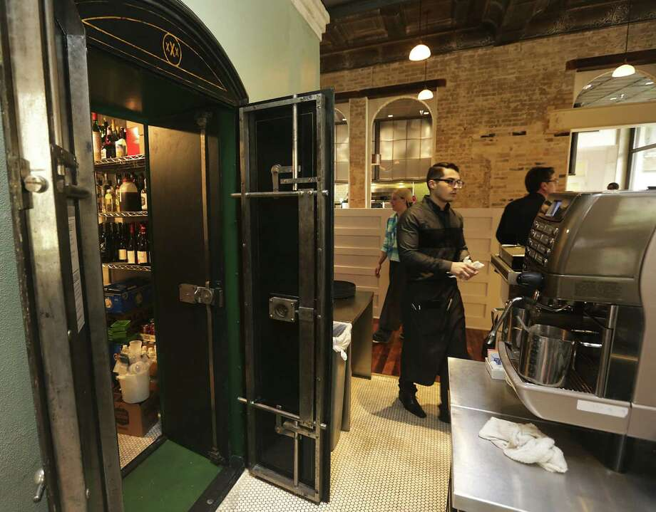 A large safe has become a walk-in storage area at Cured. Material, equipment and tools from the old brewery have been put to new uses in the Pearl complex by local architects and artists. Photo: Bob Owen / San Antonio Express-News / ©2013 San Antonio Express-News
