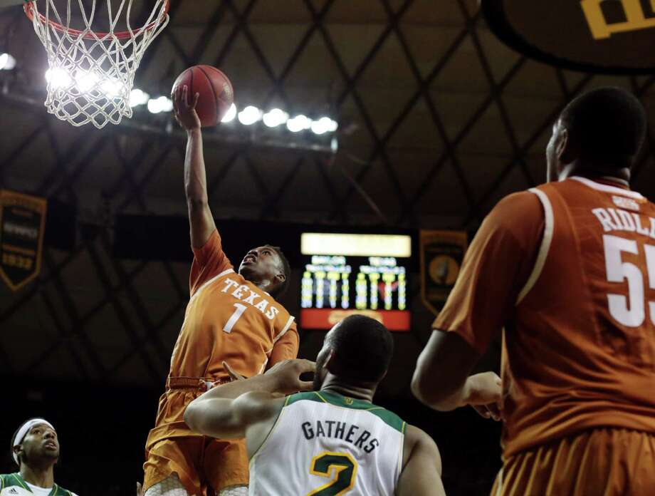 Texas freshman guard Isaiah Taylor, who had 27 points, lays the ball in over Rico Gathers during the Longhorns' 74-60 upset of No. 24 Baylor, their third straight win over a Top 25 team. Photo: Shelby Tauber / Associated Press / The Daily Texan