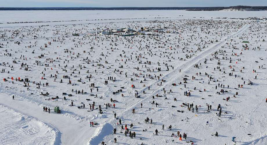 Over 10,000 anglers from the midwest and Minnesota took part in the 24th annual Brainerd Jaycees $150,000 Ice Fishing Extravaganza on Gull Lake's Hole in the Day Bay  Saturday Jan. 25, 2014.  The fishermen competed for over $200,000 in prizes and all proceeds benefited area charities. (AP Photo/Star Tribune, Bruce Bisping) Photo: Bruce Bisping, Associated Press