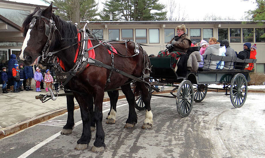 Visitors to Winterfest at Earthplace could take horse-drawn wagon rides around the nature preserve Saturday. Photo: Mike Lauterborn / Westport News contributed