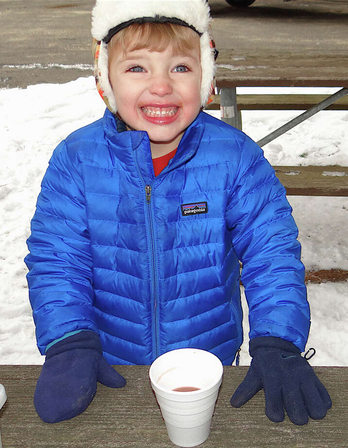 Oliver Smith, 3, of Southport, clearly enjoyed the hot chocolate being served Saturday at Earthplace. Photo: Mike Lauterborn / Westport News contributed